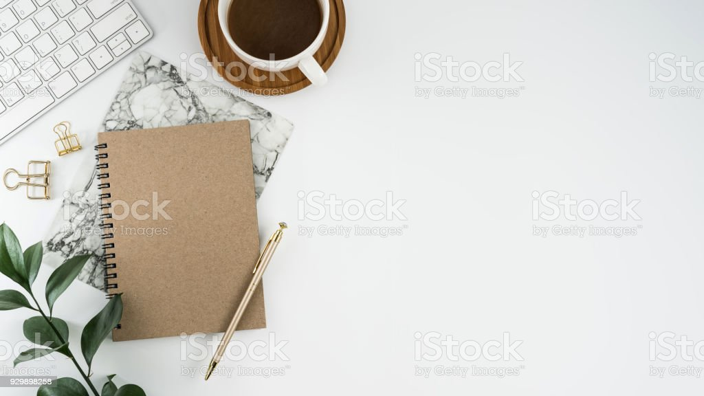 Styled stock photography white office desk table with blank notebook, computer, supplies and coffee cup. Top view with copy space. Flat lay. - Zbiór zdjęć royalty-free (Bez ludzi)