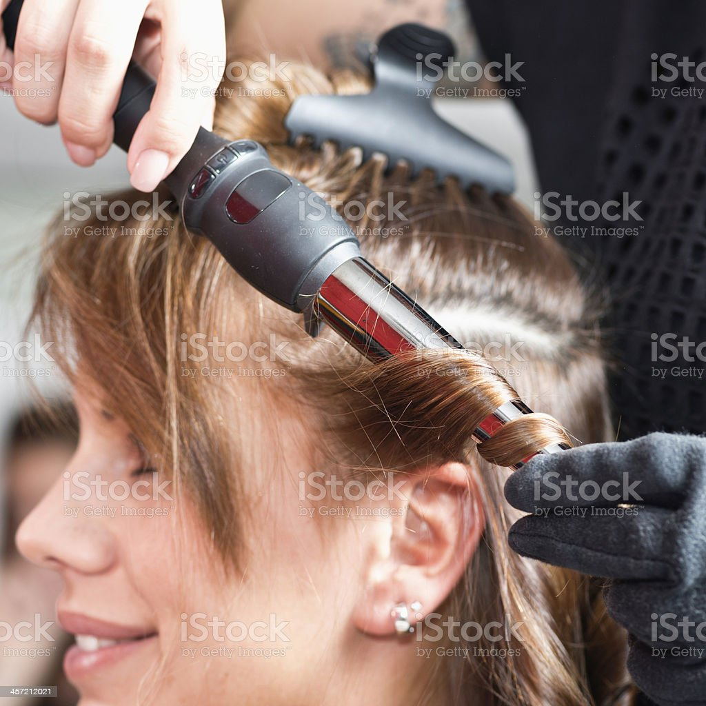 Styling hair in salon royalty-free stock photo