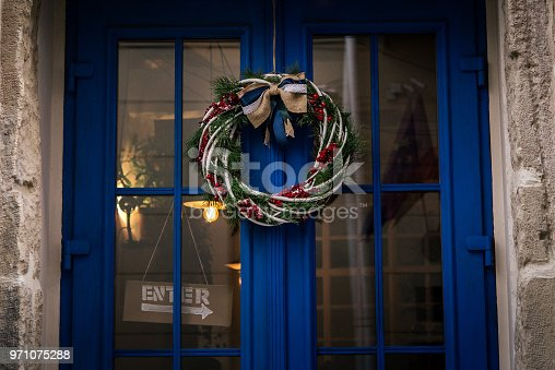 istock stylish amazing christmas wreath on blue door, celebration decoration for holidays in the city 971075288
