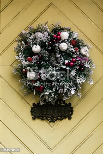 istock stylish amazing christmas wreath on geometry door, celebration decoration for holidays in the city 971075404