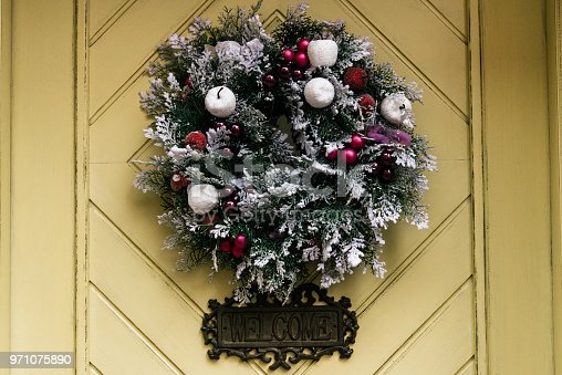 istock stylish amazing christmas wreath on geometry door, celebration decoration for holidays in the city 971075890