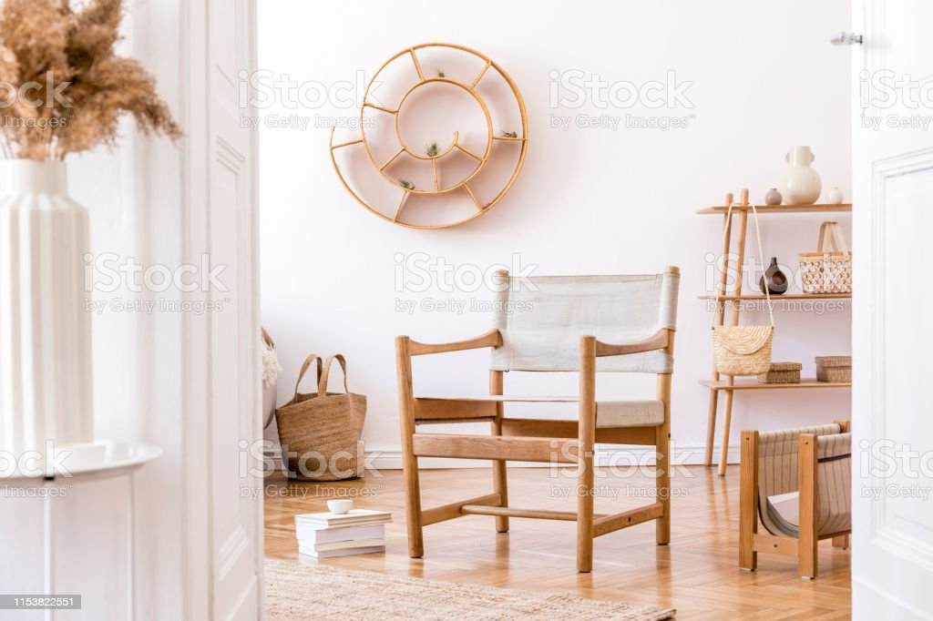 Stylish And Cozy Interior Of Living Room With Elegant Rattan Accessories Design Furnitures And Wooden Shelf Korean Style Of Home Decor Hanging Rattan Leaf Bags And Snail On The White Walls Stock