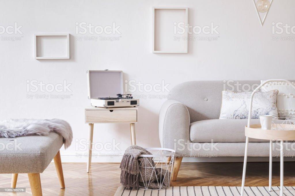 Design scandinavian white interior with grey sofa and furniture. Mock...