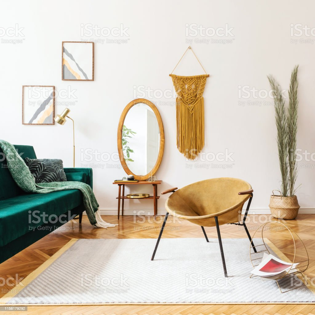 Picture of: Stylish And Elegant Interior Of Living Room With Design Gold Armchair Velvet Sofa Lamp Poster Frames Dressing Table With Mirror Plants Palm Leaves Yellow Macrame And Accessories Home Decor Stock Photo