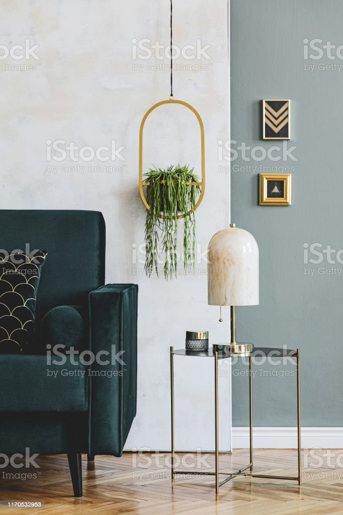 Stylish And Luxury Interior Design Of Living Room With Green Velvet Sofa Design Coffee Table Marble Table Lamp Hanging Gold Flowerbed And Elegant Accessories Template Modern Home Decor Stock Photo Download