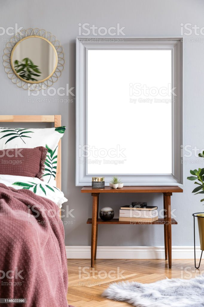 Stylish And Luxury Interior Of Bedroom With Design Furnitures Gray Mock Up Frame Gold Mirror Plants And Elegant Accessories Beautiful Floral Bed Sheets Blankets And Pillows Modern Home Decor Stock Photo