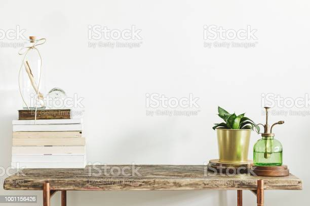 Stylish and modern decor with wooden console books plants and copy picture id1001156426?b=1&k=6&m=1001156426&s=612x612&h=mmzmk6rugpsjhaxfdztehj3cdrncsfqyjanffjt6gee=