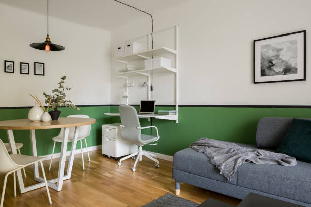 Stylish apartment with green walls stock photo