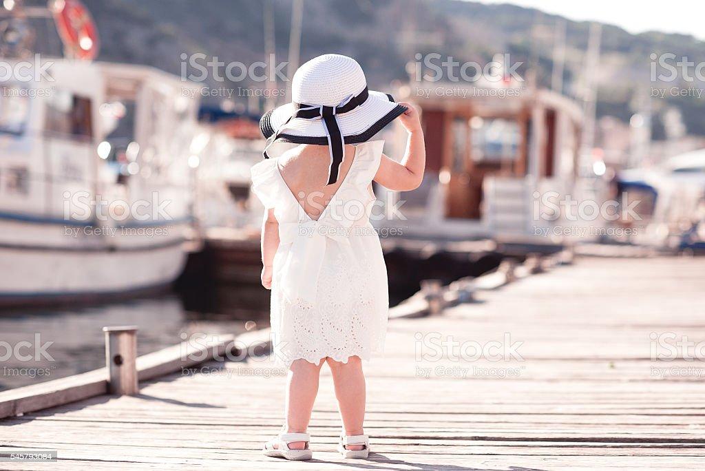 Stylish baby girl looking at sea ロイヤリティフリーストックフォト