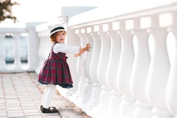 Stylish baby girl outdoors stock photo