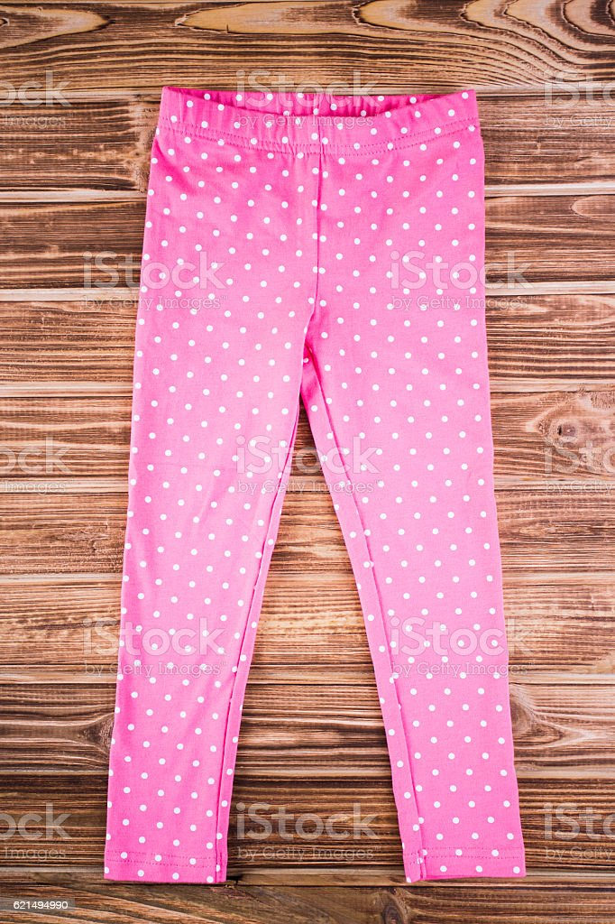 Stylish baby pink pants on the wooden background photo libre de droits