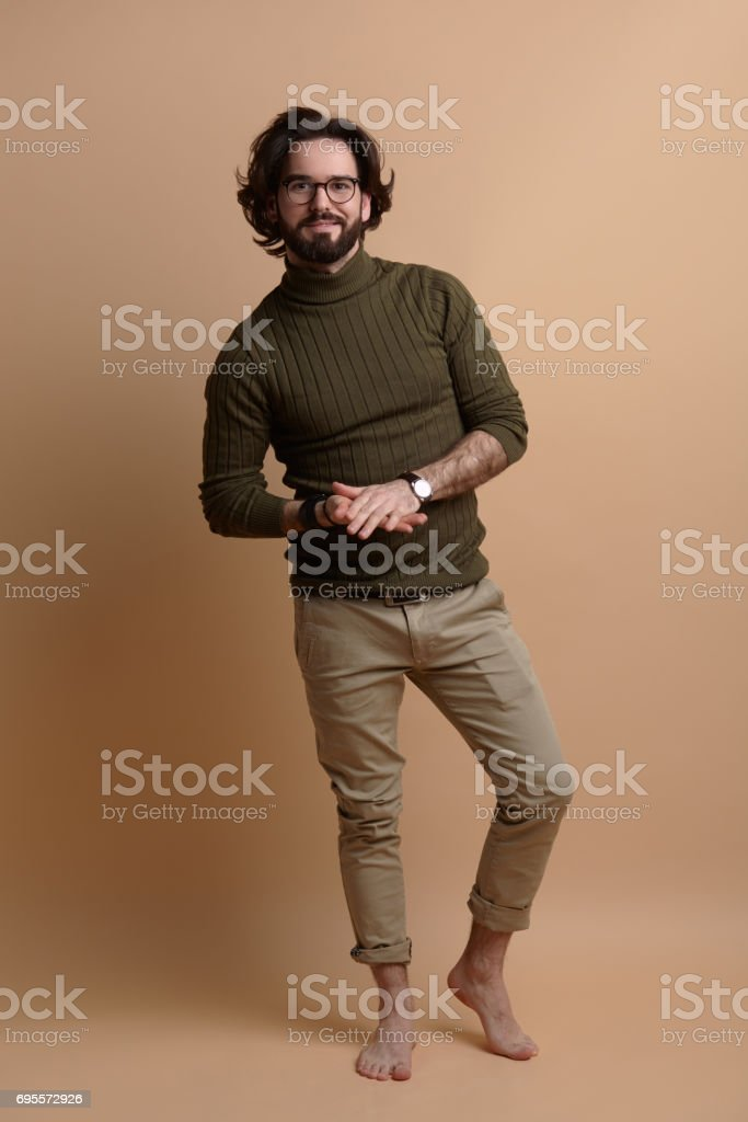 Stylish barefoot man in studio stock photo