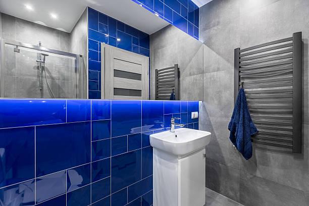 Stylish bathroom in blue and grey – Foto