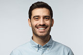 Stylish bearded business man smiling to camera, having pleased expression and cheerful look. Positive emotions concept.