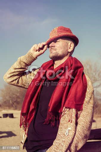 636829300 istock photo Stylish bearded man in funny hat 511116822