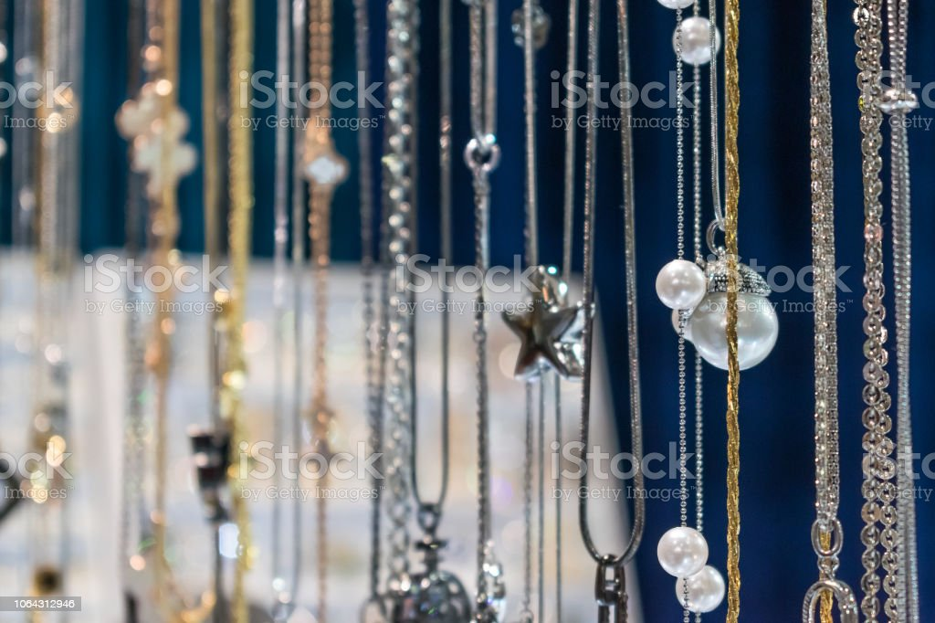 Stylish beautiful bijouterie hanging on the stand in the accessories...