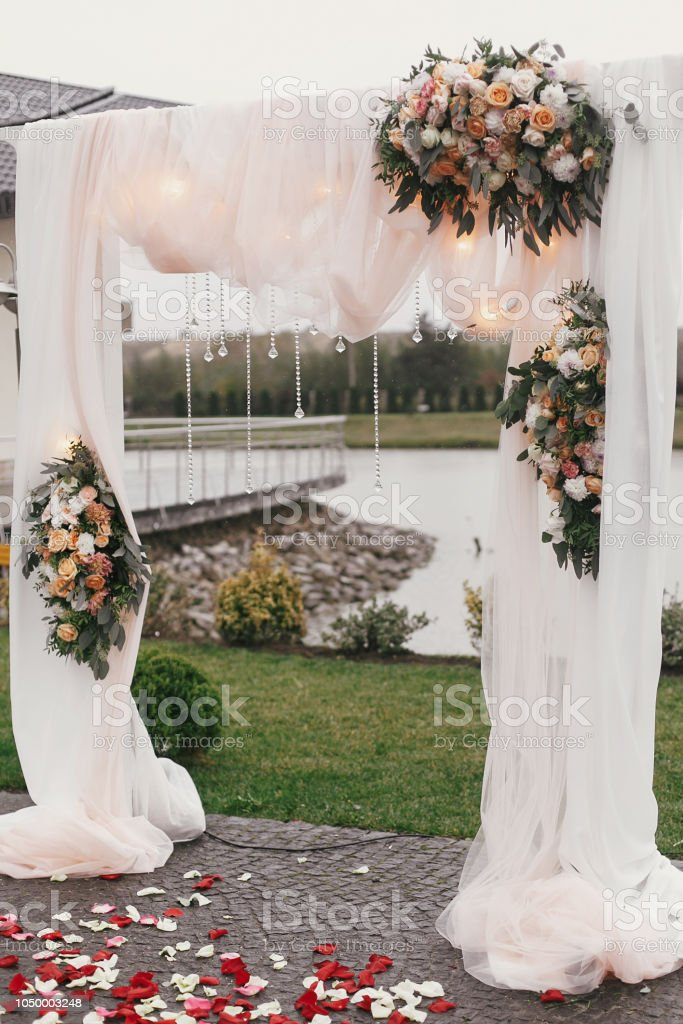 Stylish Beautiful Wedding Arch With Big Bouquets With Roses Pastel