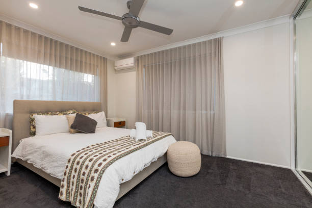 Stylish bedroom in new home Stylish bedroom in new Australian home ceiling fan stock pictures, royalty-free photos & images