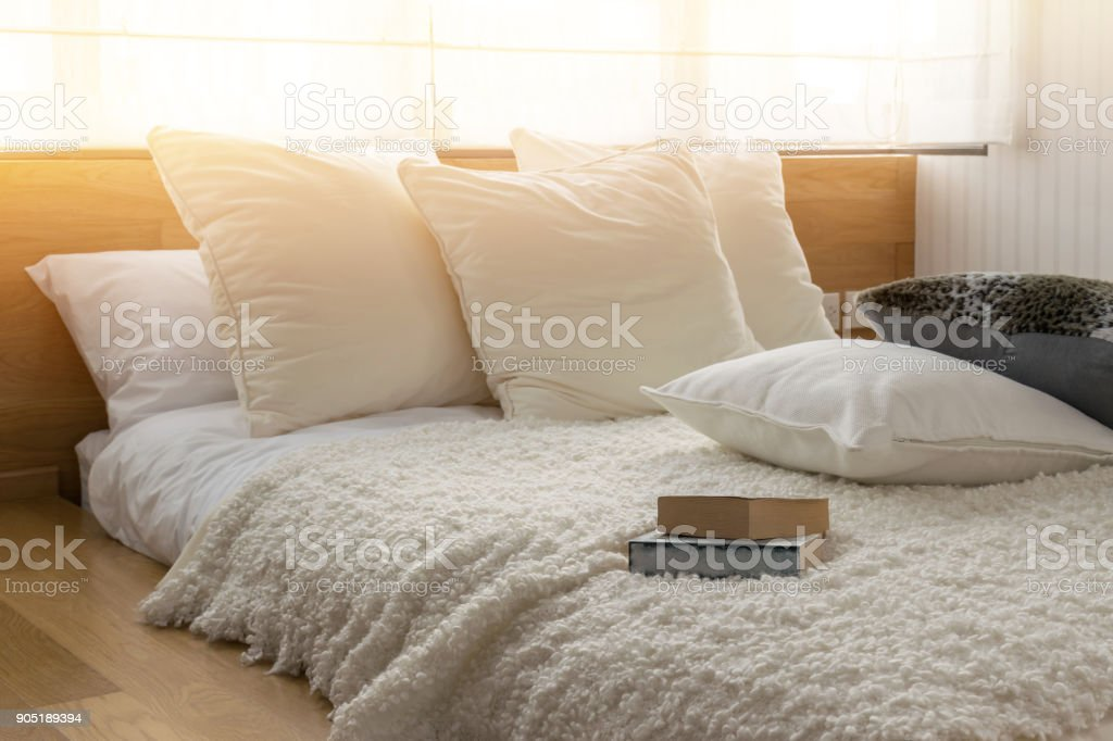 stylish bedroom interior design with black and white pillows on bed. stock photo