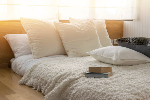 stylish bedroom interior design with black and white pillows on bed. - подушка стоковые фото и изображения
