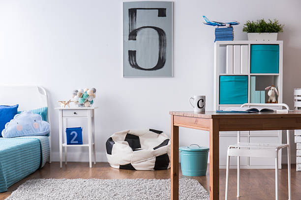 stylish bedroom perfect for football fan boy - fußball themenzimmer stock-fotos und bilder