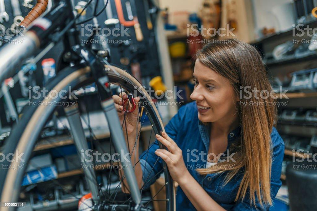 Mechanic repairing gears of bicycle. Repair and tuning, adjustment,...