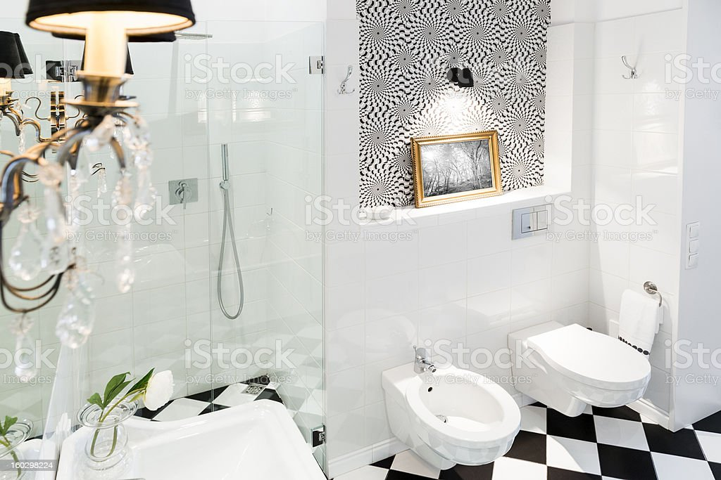 Stylish black and white bathroom interior with checkered patterns stock photo