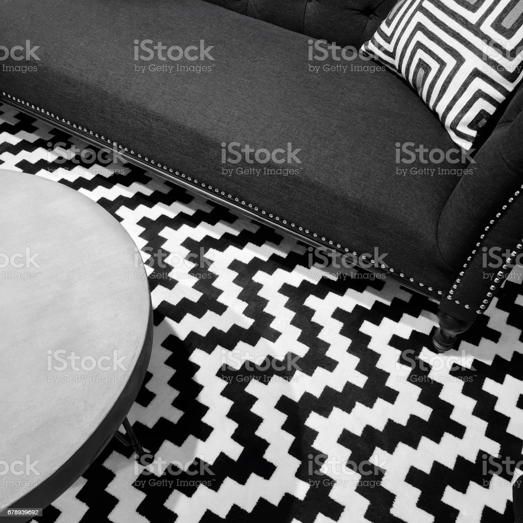 Stylish black and white interior Stylish black and white interior with textile sofa and round table. Arts Culture and Entertainment Stock Photo