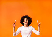 istock Stylish black man in glasses pointing away at empty space 1160982662