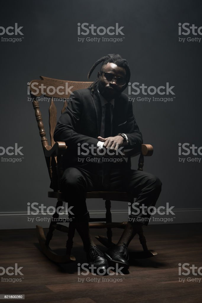 Picture of: Stylish Black Man In Rocking Chair Stock Photo Download Image Now Istock