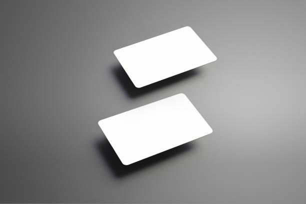stilvolle leer mock-up von einem zwei bank-geschenk-karten auf einem grauen hintergrund. - gutschein ausdrucken stock-fotos und bilder