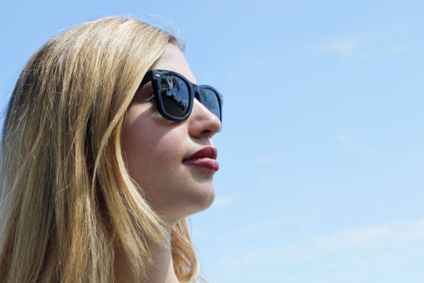 stylish blonde bulgarian outdoor girl in black sunglasses - whiteway bulgarian outdoor girl stock photos and pictures