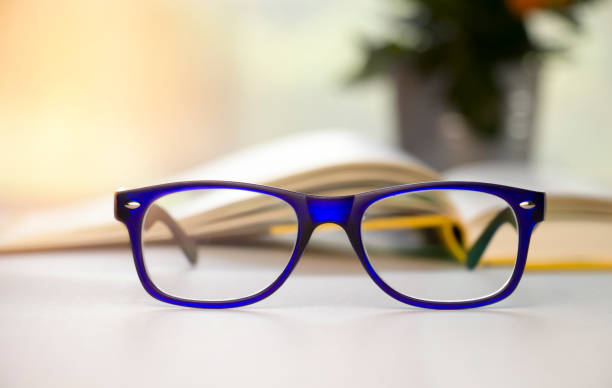 Stylish blue glasses on a blur background. stock photo