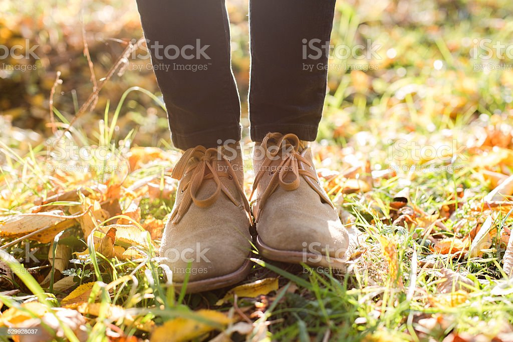 stylish boots on autumn background stock photo