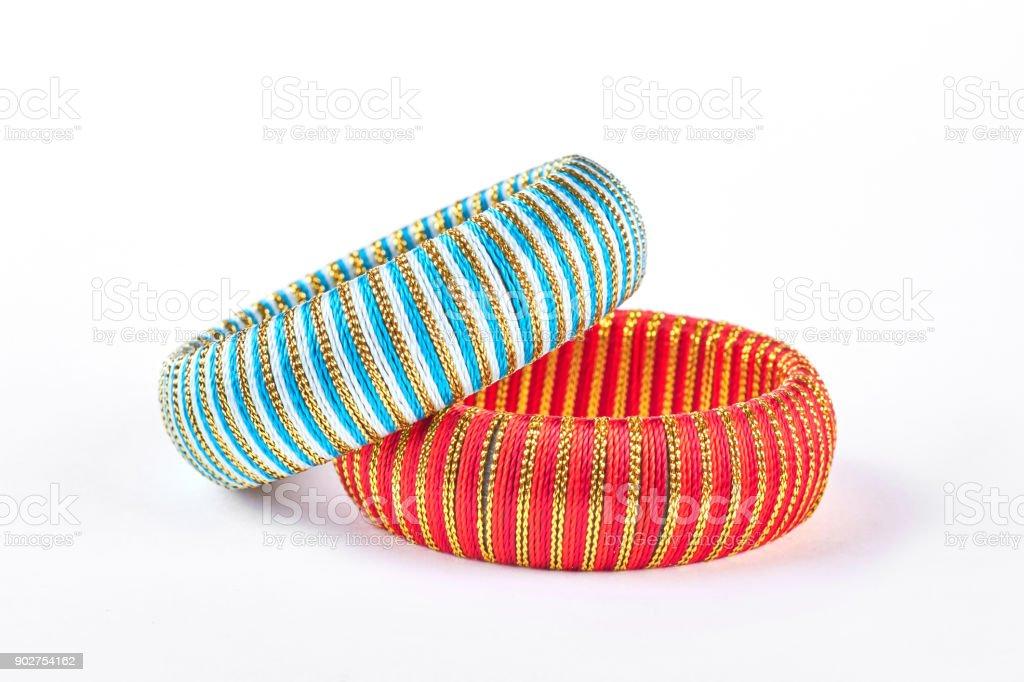 Stylish bracelets on white background. stock photo