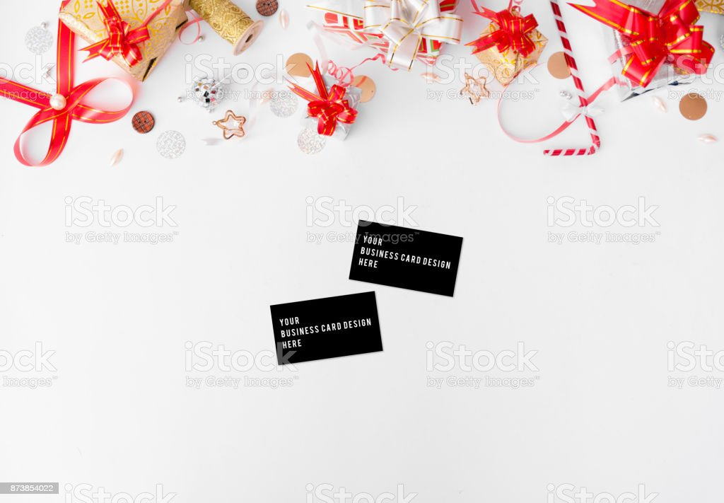 stylish business card mock up for christmas and new year, cones and christmas decorations on white background, flat lay top view. stock photo