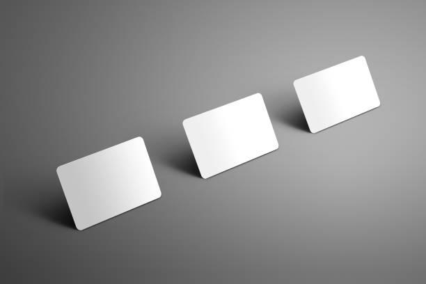 stilvolle business-template von drei leere (geschenk) bankkarte auf einem hintergrund. - gutschein ausdrucken stock-fotos und bilder