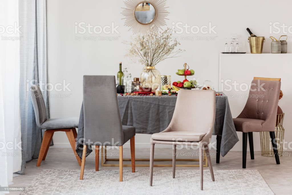 Stylish Chairs At Table In Elegant Dining Room Interior With Fancy Mirror On The Wall Stock Photo Download Image Now Istock
