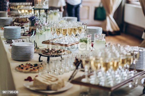 istock stylish champagne glasses and food  appetizers on table at wedding reception. luxury catering at celebrations. serving food and drinks at events concept 961798406