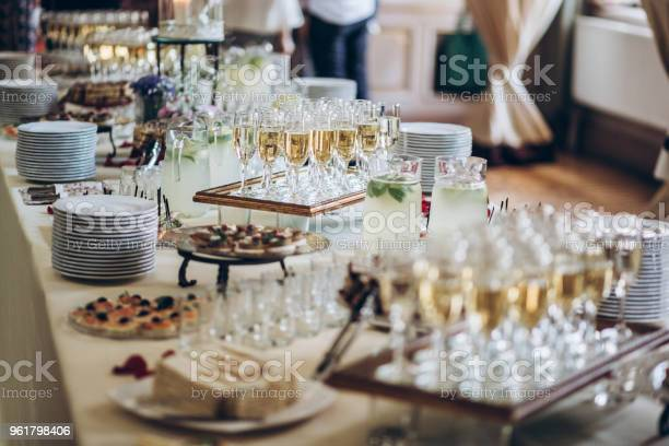 Stylish champagne glasses and food appetizers on table at wedding picture id961798406?b=1&k=6&m=961798406&s=612x612&h=52j3agvmx5k6wtxmtbnlz8ejffs1jgfnklorvimzyws=
