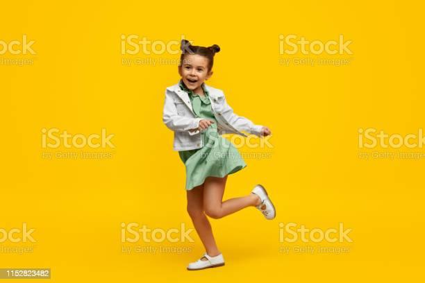 Stylish child smiling and dancing picture id1152823482?b=1&k=6&m=1152823482&s=612x612&h=kpyipasv2ldcvmxjheihn6bmzvhls80bukpsmnq oyo=