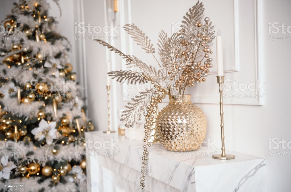 Stylish Christmas Living Room Decor In Gold And Silver Tones A Large Beautifully Decorated Christmas Tree Stands In The Room Next To The Modern Sofa Stock Photo Download Image Now Istock