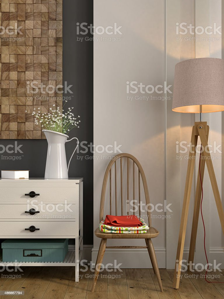 Stylish composition with a white chest of drawers and a chair stock photo