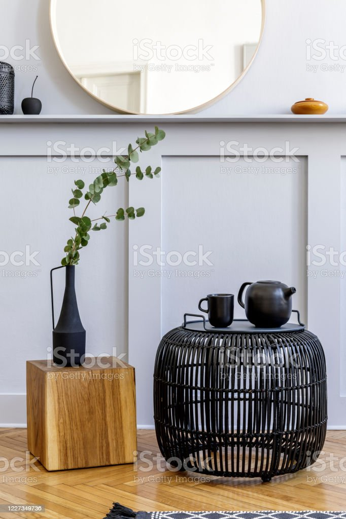 Stylish Concept At Living Room Interior With Black Rattan Coffee Table Round Mirror Flowers In Vase Lantern Shelf Wooden Cube And Elegant Personal Accessories In Modern Home Decor Stock Photo Download