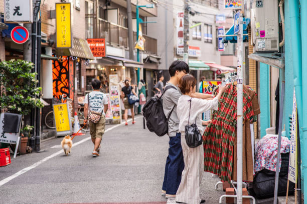 A stylish couple goes vintage shopping in Shimokitazawa stock photo
