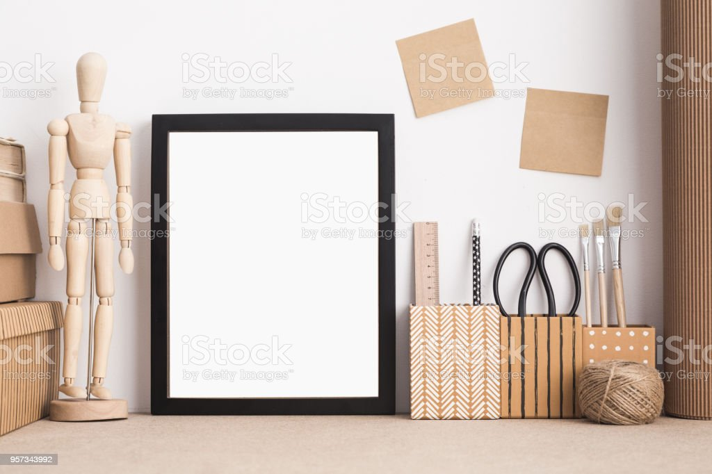 Stylish, creative desktop mock up with black frame, dummy, office supplies. stock photo