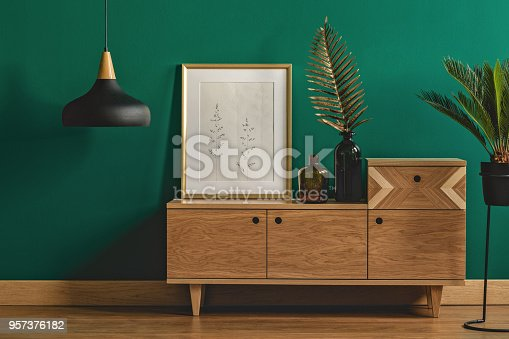 istock Stylish dark green interior 957376182
