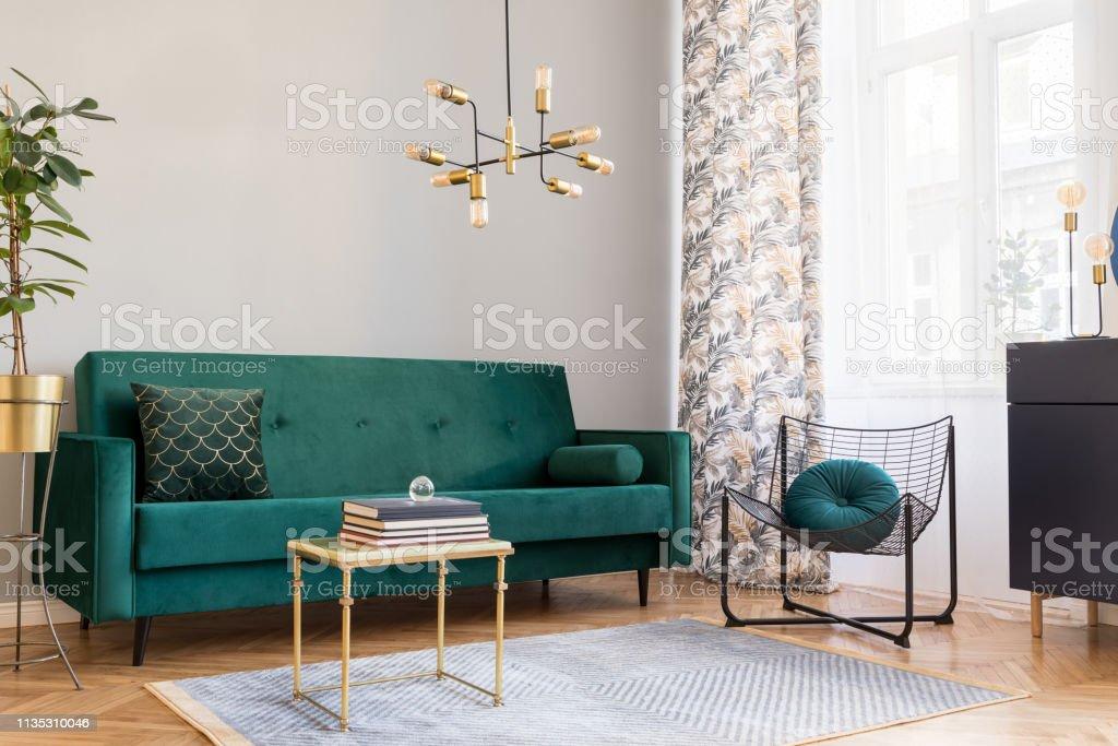 Elegant interior with big window, brown wooden parquet and grey...