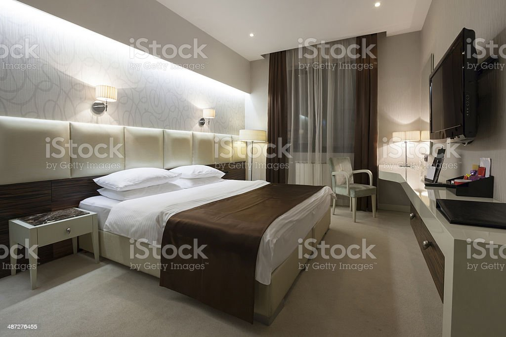 Stylish double bed hotel room stock photo
