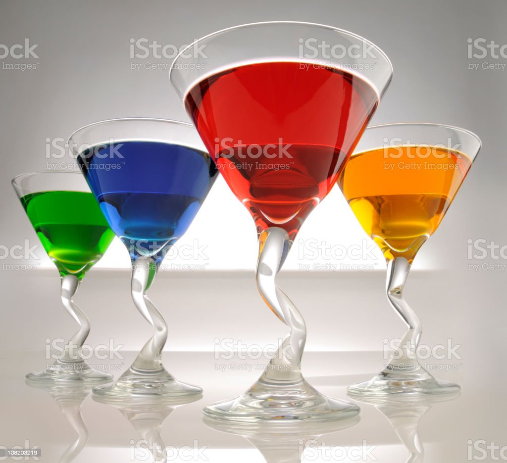 Stylish Drinking Glasses With Colorful Drinks Stock Photo